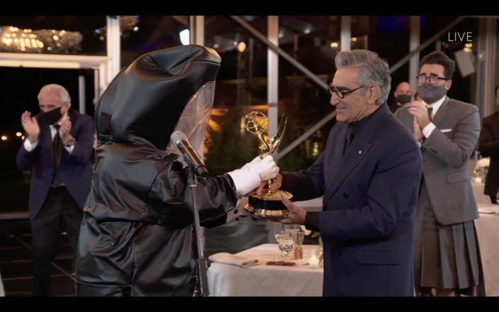 Hazmat suits and an Emmy statuette turned into a hand sanitizer dispenser were among some of the show's pandemic-focused gags.