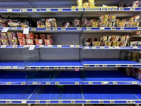 """<span class=""""caption"""">Shelves of ready noodles in Singapore were left empty after fear led people to panic buy</span> <span class=""""attribution""""><a class=""""link rapid-noclick-resp"""" href=""""https://www.shutterstock.com/image-photo/singapore-february-8-2020-panicbuying-supermarkets-1659421018"""" rel=""""nofollow noopener"""" target=""""_blank"""" data-ylk=""""slk:kandl/Shutterstock"""">kandl/Shutterstock</a></span>"""