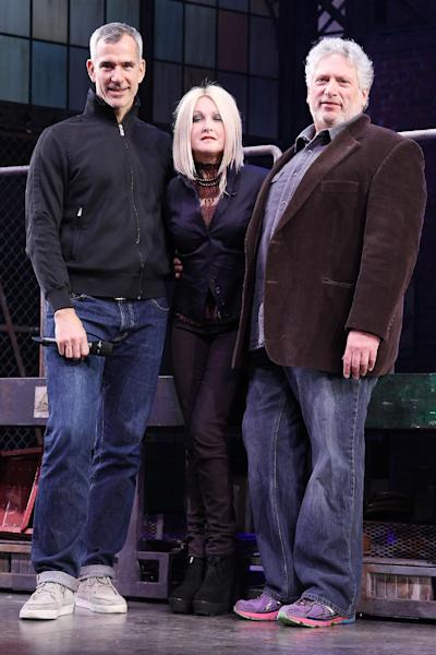 """FILE - This Feb. 28, 2013 photo released by Starpix shows, from left, choreographer Jerry Mitchell, Cyndi Lauper and Harvey Fierstein at the open house for the Upcoming Musical """"Kinky Boots,"""" at the Al Hirshfeld Theatre in New York. The Cyndi Lauper-scored """"Kinky Boots"""" has earned a leading 13 Tony Award nominations, Tuesday, April 30, 2013. """"Kinky Boots"""" is based on the 2005 British movie about a real-life shoe factory that struggles until it finds new life in fetish footwear. Lauper's songs and a story by Harvey Fierstein have made it a crowd-pleaser. (AP Photo/Starpix, Kristina Bumphrey)"""