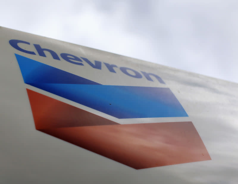 FILE PHOTO: A Chevron gas station sign is shown at one of their retain gas stations in Cardiff, California