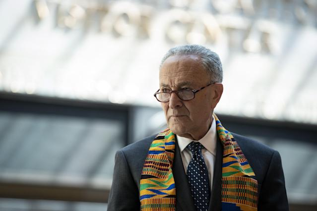 Sen. Chuck Schumer wears a kente cloth before a moment of silence in Emancipation Hall at the U.S. Capitol. (Al Drago/Bloomberg via Getty Images)
