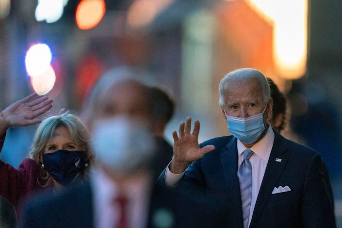 President-elect Joe Biden and his wife Jill Biden wave as they leave the The Queen theater, Tuesday, Nov. 24, 2020, in Wilmington, Delaware.