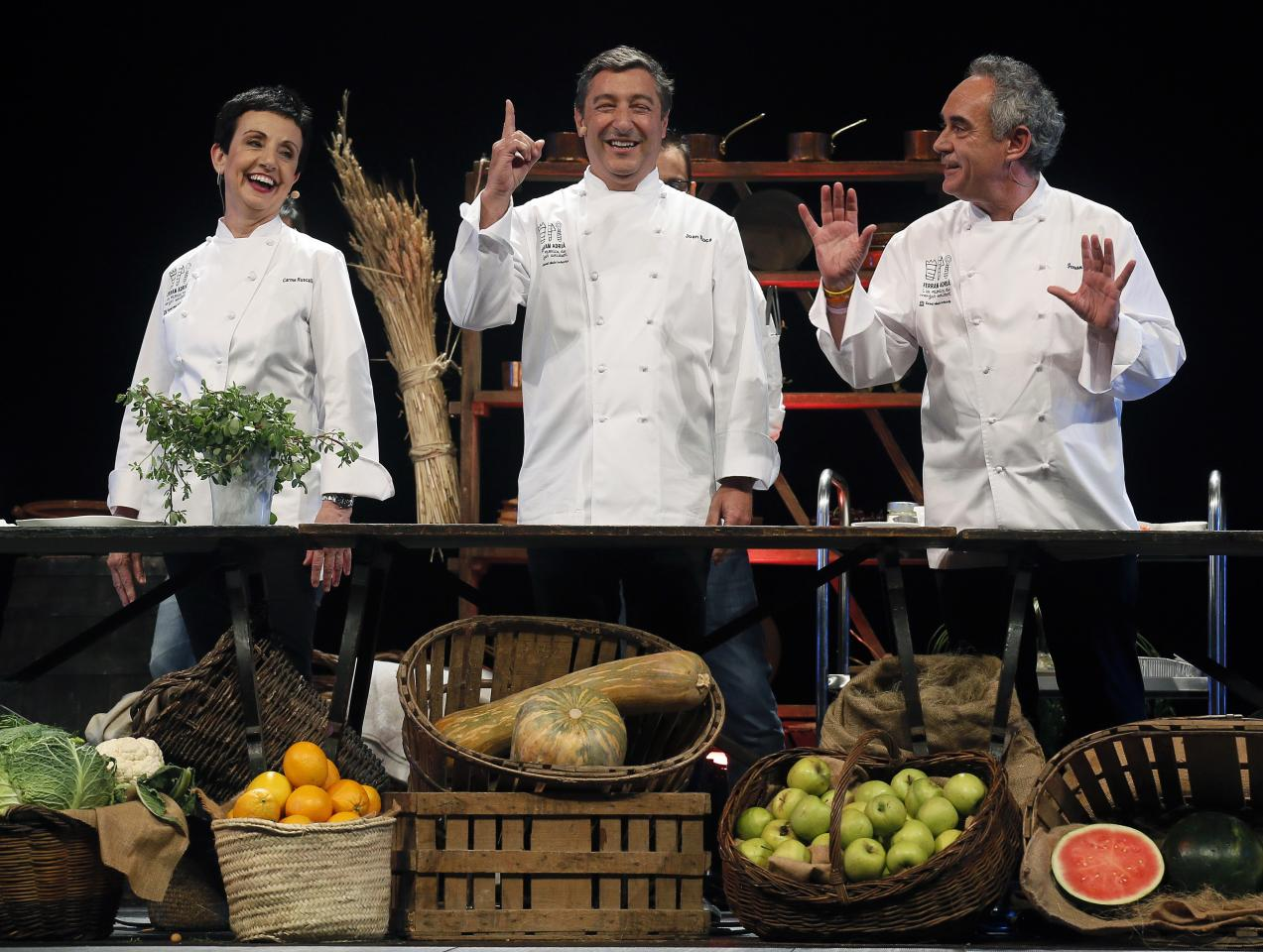 "Spanish chefs Joan Roca (C) of El Celler de Can Roca restaurant, Carme Ruscalleda (L) of Sant Pau restaurant and Ferran Adria (R) of El Bulli restaurant joke during the ""La Fabrica del Menjar Solidari"" (The Factory of the Food Charity) charity show at Liceu theatre in Barcelona June 29, 2014. The proceeds of the show, which is hosted by Adria and includes cooking performances, go to charity. REUTERS/Albert Gea (SPAIN - Tags: ENTERTAINMENT FOOD SOCIETY)"