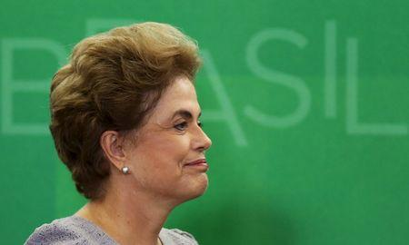 Brazil's President Rousseff smiles as she attends a meeting with jurists at Planalto Palace in Brasilia