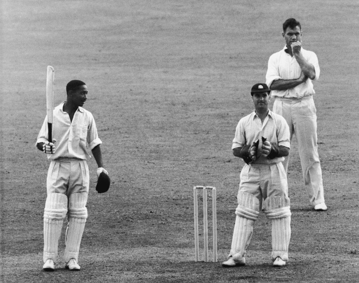 West Indian cricketer Frank Worrell (1924 - 1967, left) acknowledges the cheers upon reaching his 200th run in the Test Match against England at Nottingham, 1950. (Photo by Central Press/Hulton Archive/Getty Images)