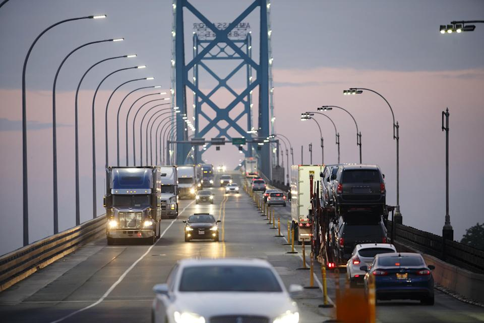 Commercial trucks and passenger vehicles drive across Ambassador Bridge on the Canada-U.S. border in Windsor, Ontario, Canada, on Thursday, Aug. 9, 2018. The Ambassador Bridge connects Canada to USA, from Windsor to Detroit and facilitates over 30 per cent of all Canada-US road trade. (Photo from Cole Burston/Bloomberg via Getty Images)