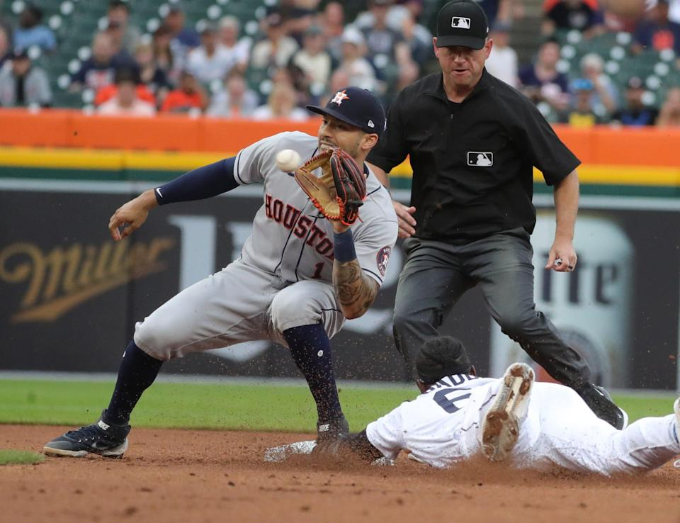 Detroit Tigers center fielder Akil Baddoo (60) is tagged out on a steal attempt by Houston Astros shortstop Carlos Correa (1) during first inning action on Thursday, June 24, 2021, at Comerica Park in Detroit.