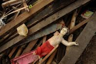 A religious icon, a statue of the infant Jesus, is seen among debris of destroyed houses in Tacloban, Leyte province, Philippines on December 7, 2013