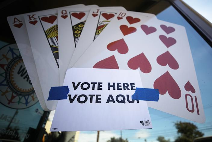 """A """"Vote Here"""" sign is posted on the final day of early voting in the Nevada caucuses in Las Vegas on Tuesday. (Photo by Mario Tama/Getty Images)"""