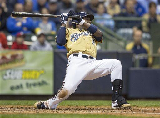 Milwaukee Brewers' Yuniesky Betancourt falls to the dirt after being hit by a pitch from St. Louis Cardinals' Joe Kelly during the seventh inning of a baseball game Thursday, May 2, 2013, in Milwaukee. (AP Photo/Tom Lynn)