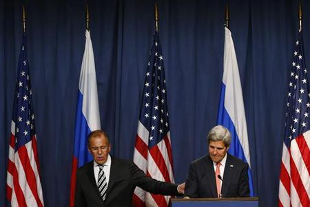 U.S. Secretary of State John Kerry and Russian Foreign Minister Sergei Lavrov (L) leave the podium after making statements following meetings regarding Syria, at a news conference in Geneva September 14, 2013. The United States and Russia have agreed on a proposal to eliminate Syria's chemical weapons arsenal, Kerry said on Saturday after nearly three days of talks with Lavrov. REUTERS/Ruben Sprich