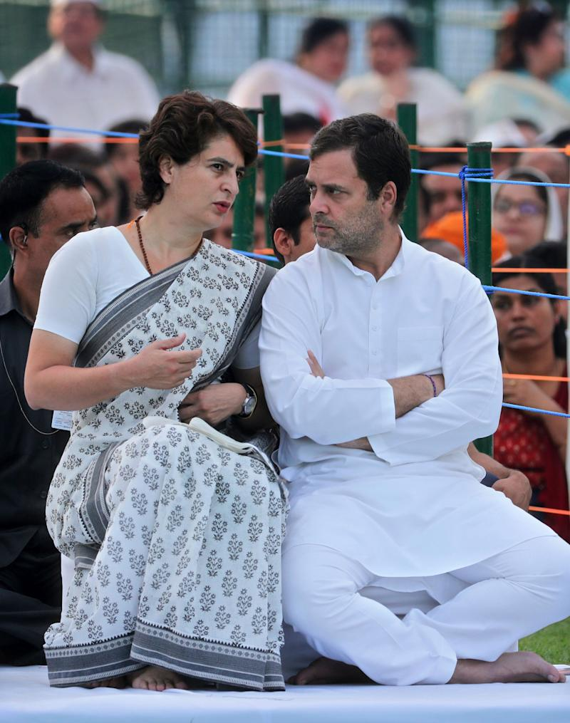 Congress Party President Rahul Gandhi, right, talks to his sister and party general secretary Priyanka Gandhi Vadra during a function to pay homage to their father and former Indian prime minister Rajiv Gandhi on his death anniversary in New Delhi, India, Tuesday, May 21, 2019. Gandhi was assassinated during national elections by a suicide bomber in 1991. (AP Photo/Manish Swarup)