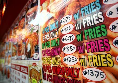 Menues for fried food are displayed at a fast food restaraunt New York