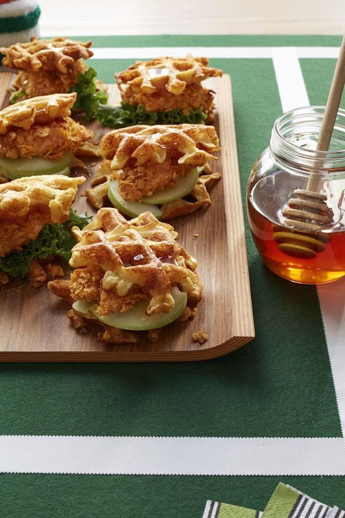 """<p>We all know that chicken and waffles are a match made in heaven. Turn the combination into sliders, and eat them with your hands! </p><p><a href=""""https://www.womansday.com/food-recipes/food-drinks/recipes/a53335/chicken-and-buttermilk-waffles/"""" rel=""""nofollow noopener"""" target=""""_blank"""" data-ylk=""""slk:Get the Chicken and Buttermilk Waffles recipe."""" class=""""link rapid-noclick-resp""""><em>Get the Chicken and Buttermilk Waffles recipe.</em></a> </p>"""