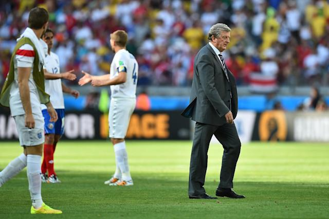 England's coach Roy Hodgson (R) walks on the pitch after the Group D football match between Costa Rica and England at The Mineirao Stadium in Belo Horizonte on June 24, 2014,during the 2014 FIFA World Cup (AFP Photo/Ben Stansall)