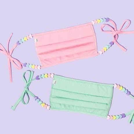 """<h3><a href=""""https://fave.co/2ZrLNk9"""" rel=""""nofollow noopener"""" target=""""_blank"""" data-ylk=""""slk:Stoney Clover Lane Pastel Heart Mask Set"""" class=""""link rapid-noclick-resp"""">Stoney Clover Lane Pastel Heart Mask Set</a></h3> <br>For anyone who can't resist a refreshing pop of pastel for summer, Stoney Clover's pink and mint-hued cotton masks are definitely the way to go. The adjustable straps mean this mask can be tied to your perfect size, with the option of adding a heart-shaped bead or two for a touch of whimsy. Available in standard and petite styles, the latter can be worn either by kids or by adults who want a more snug fit.<br><br><strong>Stoney Clover Lane</strong> Pastel Heart Masks Set of 2, $, available at <a href=""""https://go.skimresources.com/?id=30283X879131&url=https%3A%2F%2Ffave.co%2F2ZrLNk9"""" rel=""""nofollow noopener"""" target=""""_blank"""" data-ylk=""""slk:Stoney Clover Lane"""" class=""""link rapid-noclick-resp"""">Stoney Clover Lane</a><br>"""