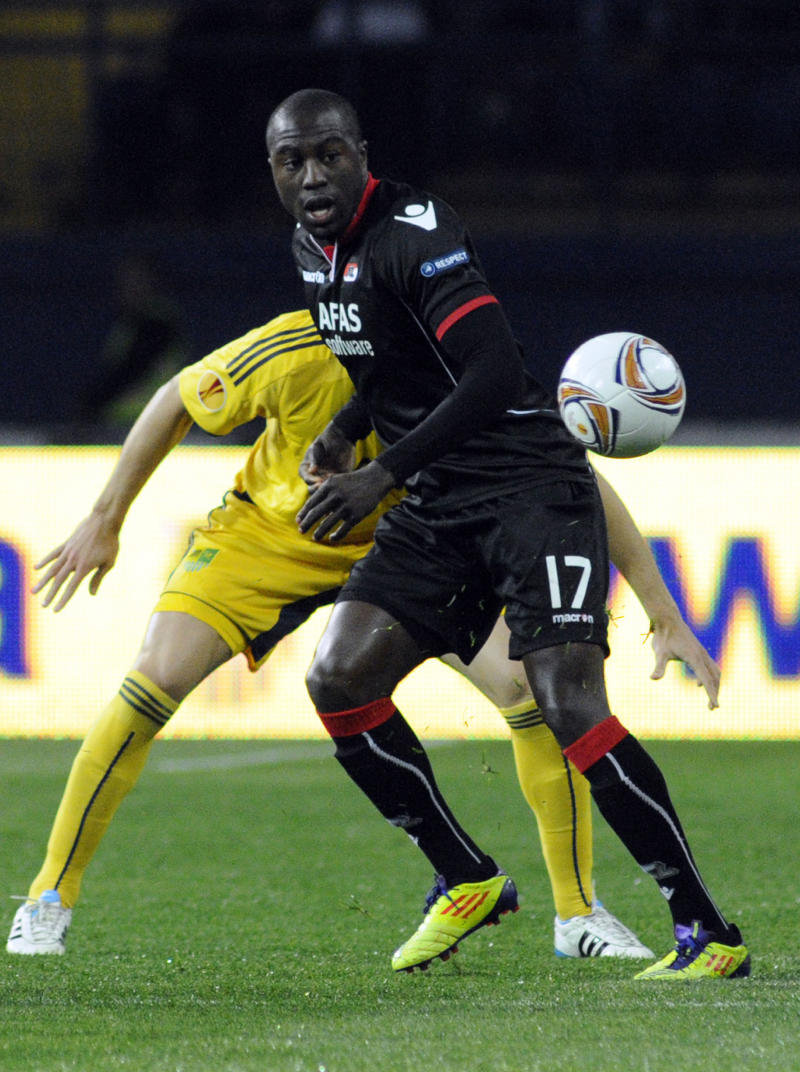 FILE - In this Sept. 29, 2011, file photo, AZ Alkmaar's Jozy Altidore (17) challenges an unidentified FC Metalist Kharkiv player for the ball during their UEFA Europa League group stage  soccer match Group G in Kharkiv, Ukraine. Altidore broke Clint Dempsey's record for most goals by an American in a European club season, scoring his 24th on Sunday, March 3, 2013, in AZ Alkmaar's 2-1 loss at RKC Waalwijk in the Dutch Eridivisie. (AP Photo/Sergei Chuzavkov, file)