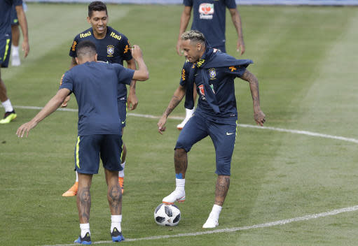 Brazil's Neymar practices during a training session in Sochi, Russia, Tuesday, June 19, 2018. Brazil will face Costa Rica on June 22 in the group E for the soccer World Cup. (AP Photo/Andre Penner)