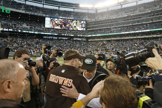 New York Jets head coach Rex Ryan, center right, greets Cleveland Browns head coach Rob Chudzinski at midfield after an NFL football game on Sunday, Dec. 22, 2013, in East Rutherford, N.J. The Jets won the game 24-13. (AP Photo/Kathy Willens)