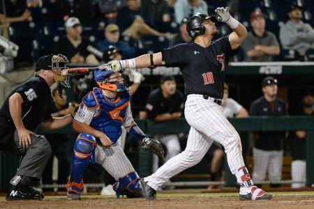 Jun 21, 2018; Omaha, NE, USA; Texas Tech Red Raiders designated hitter Zach Rheams (18) flies out to deep center field to end the eighth inning against the Florida Gators in the College World Series at TD Ameritrade Park. Mandatory Credit: Steven Branscombe-USA TODAY Sports