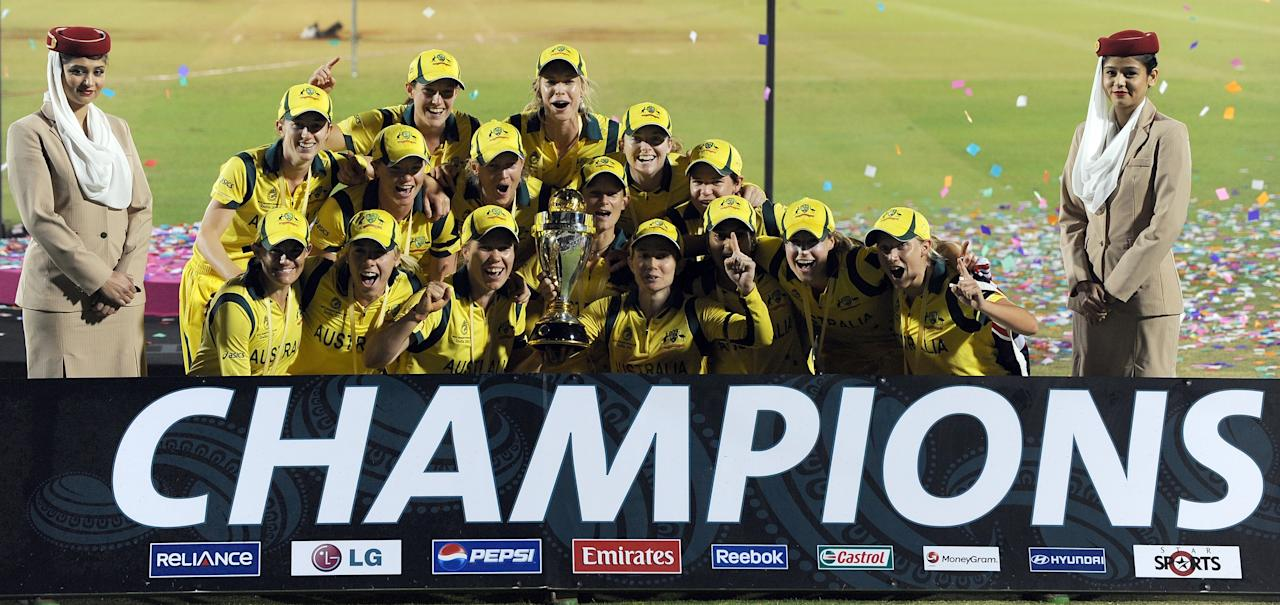 The Australian cricket team poses with their Champion's trophy after winning the ICC Women's World Cup 2013 between Australia and West Indies at the Cricket Club of India's Brabourne stadium in Mumbai on February 17, 2013. Australia won the match by 114 runs. AFP PHOTO/Indranil MUKHERJEE