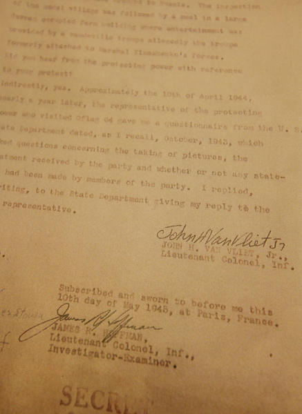 This picture taken in Warsaw, Poland, on Wednesday, Jan. 8, 2014, shows a copy of the last page of what is believed the recently uncovered vital testimony made in 1945 in Paris by U.S. Lt. Col. John H. Van Vliet Jr. It provides evidence of Soviet responsibility for the World War II massacre of some 22,000 Polish officers in Katyn forest and other locations in then-Soviet Union. Researcher Krystyna Piorkowska says she found it in November in archives near Washington, among wartime documents of the U.S. Embassy in Paris. (AP Photo/Czarek Sokolowski)
