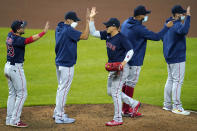 Boston Red Sox players celebrate after defeating the Baltimore Orioles 6-4 in ten innings during a baseball game, Saturday, April 10, 2021, in Baltimore. The Red Sox won 6-4 in ten innings. (AP Photo/Julio Cortez)