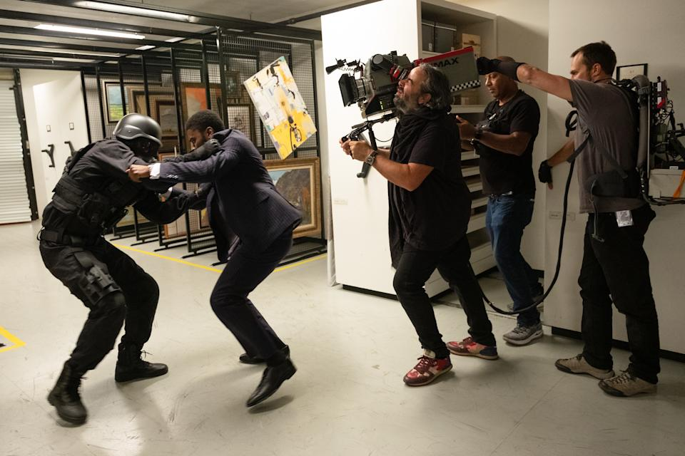 (L-r) John David Washington and DP Hoyte Van Hoytema on the set of Tenet. (Warner Bros.)