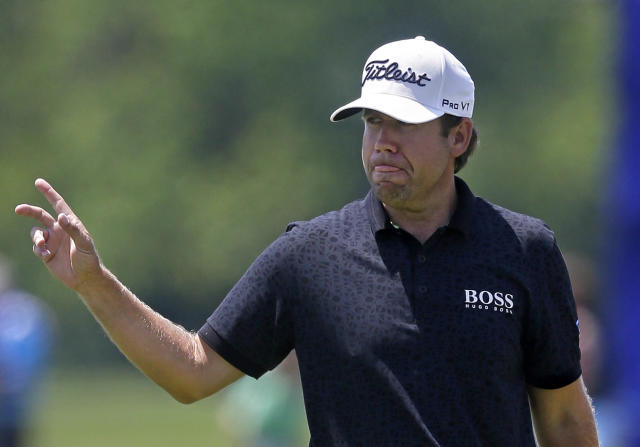 Erik Compton reacts after a birdie on the ninth hole during the opening round of the Zurich Classic golf tournament at TPC Louisiana in Avondale, La., Thursday, April 24, 2014. (AP Photo/Gerald Herbert)
