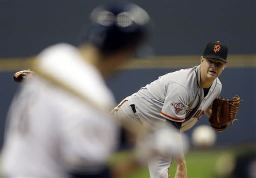 San Francisco Giants starting pitcher Matt Cain throws to Milwaukee Brewers' Ryan Braun during the first inning of a baseball game Thursday, April 18, 2013, in Milwaukee. (AP Photo/Morry Gash)