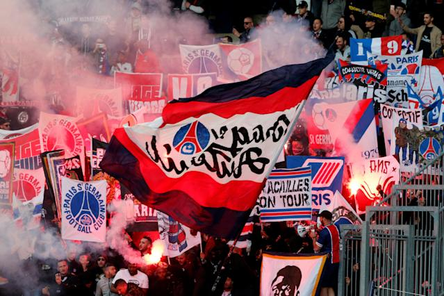 Soccer Football - Ligue 1 - Caen vs Paris St Germain - Stade Michel d'Ornano, Caen, France - May 19, 2018 Paris Saint-Germain's fans wave flags during the match REUTERS/Pascal Rossignol