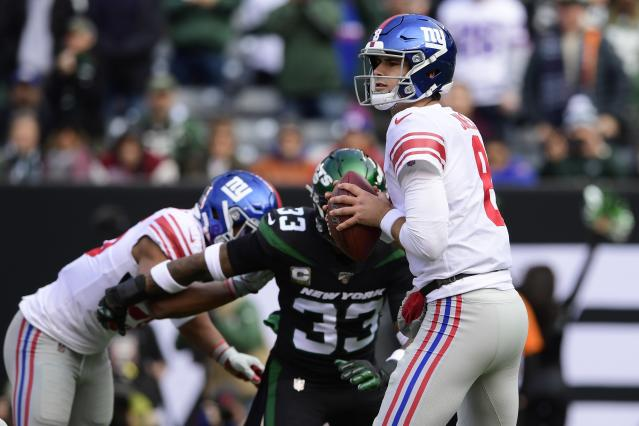 New York Giants quarterback Daniel Jones (8) looks to pass as New York Jets' Jamal Adams (33) closes in during the first half of an NFL football game Sunday, Nov. 10, 2019, in East Rutherford, N.J. Adams forced a fumble on the play. (AP Photo/Steven Ryan)