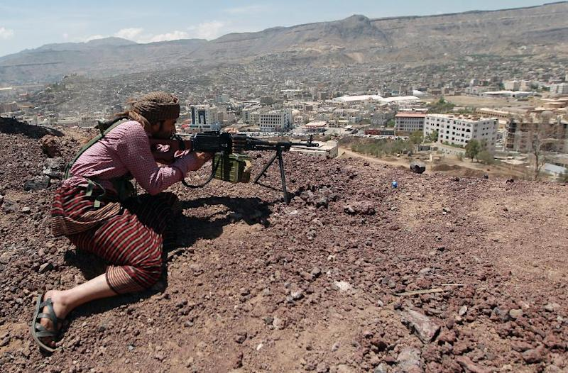 The militiamen known as Huthis stormed into Yemen's capital Sanaa on September 21, easily seizing key government installations, and they now man checkpoints and run patrols across the city in almost total absence of the security forces (AFP Photo/Mohammed Huwais)