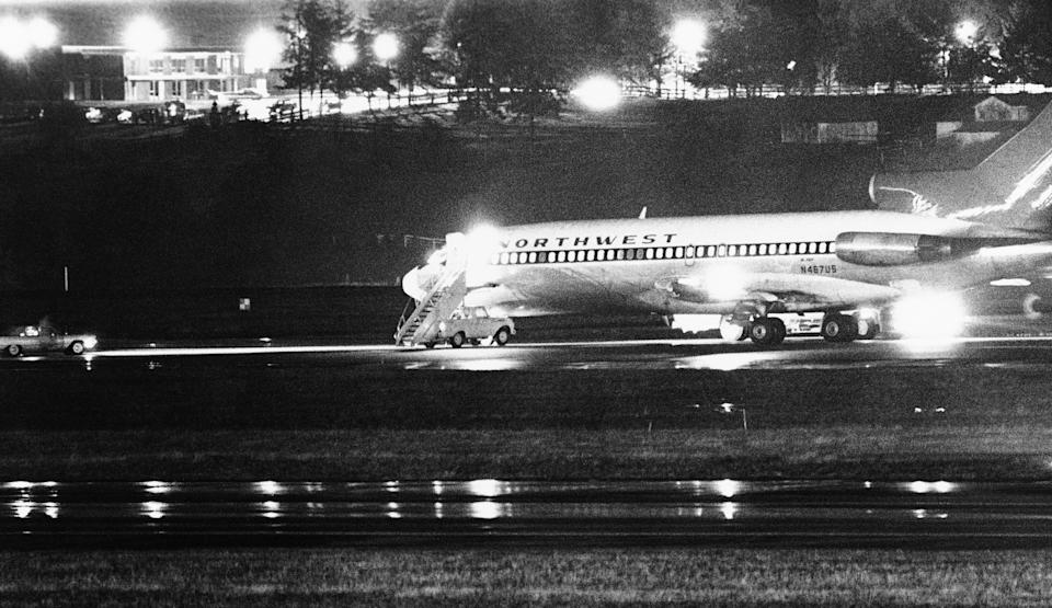 FILE -- A hijacked Northwest Airlines jetliner is seen in this Nov. 25, 1971 file photo as it sits on a runway for refueling at Seattle-Tacoma International Airport, Nov. 25, 1971, Seattle. 2011 has been a rich year for students of D.B. Cooper, the mysterious skyjacker who vanished out the back of the Boeing 727 wearing a business suit, a parachute and a pack with $200,000 in ransom money 40 years ago Thursday. (AP Photo, File)