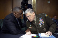 Secretary of Defense Lloyd Austin, left, and Chairman of the Joint Chiefs Chairman Gen. Mark Milley talk before a Senate Appropriations Committee hearing to examine proposed budget estimates and justification for fiscal year 2022 for the Department of Defense in Washington on Thursday, June 17, 2021. (Caroline Brehman/Pool via AP)