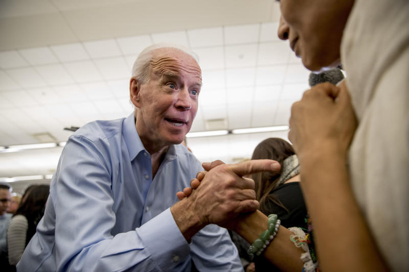 Democratic presidential candidate former Vice President Joe Biden greets members of the audience at a campaign stop at the South Slope Community Center, Saturday, Feb. 1, 2020, in North Liberty, Iowa. (AP Photo/Andrew Harnik)