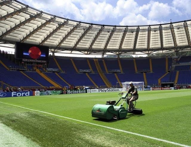 A groundsman cuts the grass at the Olympic Stadium, Rome.