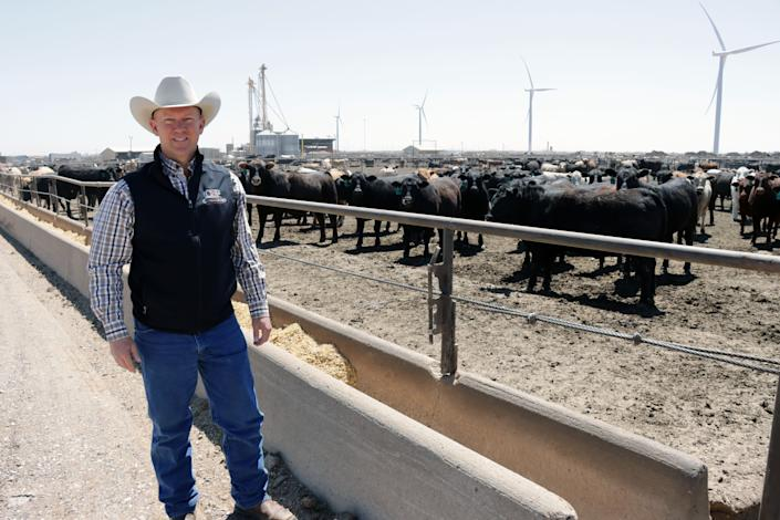 Robby Kirkland, owner of Kirkland Feedyard, standing in the middle of cow pens in Vega, TX.  The pandemic has cost the owners money in the stock market, but owner Robby Kirkland says he is grateful that his family and employees are healthy.