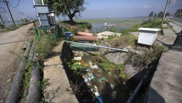 At least 15 major drains in the city empty into the sprawling lake, contaminating it with sewage and pollutants like phosphorous and nitrogen, officials say. AP