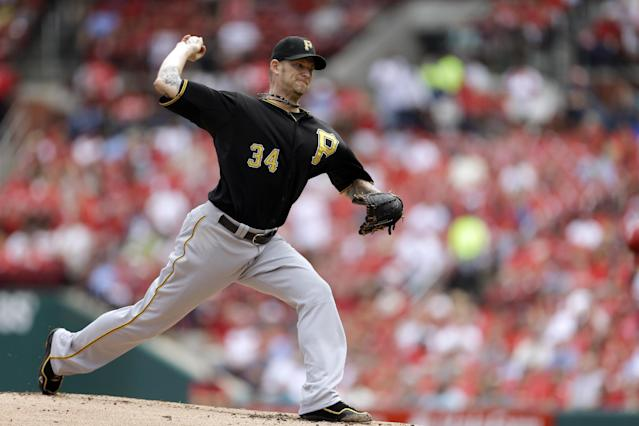 Pittsburgh Pirates starting pitcher A.J. Burnett throws during the first inning of a baseball game against the St. Louis Cardinals on Thursday, Aug. 15, 2013, in St. Louis. (AP Photo/Jeff Roberson)