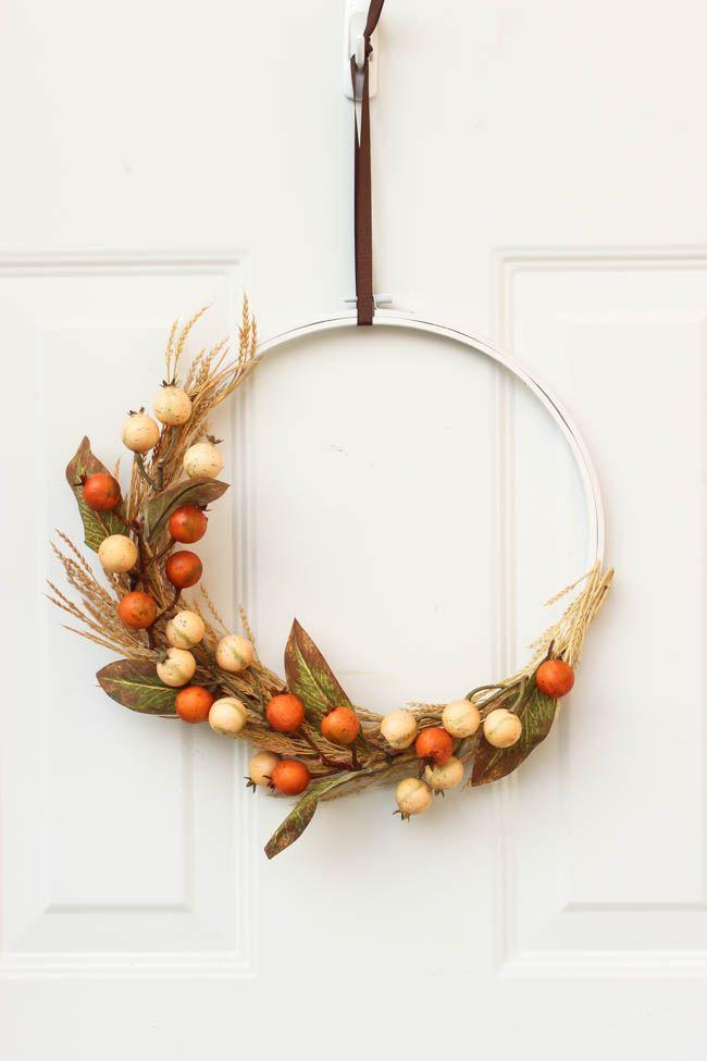 """<p>Use an old embroidery hoop and transform it into a beauitful wreath by adding faux berries and <a href=""""https://www.amazon.com/BELLAUSA-Preserved-Standing-Bouquet-NaturalBride/dp/B077BQHHJ6/?tag=syn-yahoo-20&ascsubtag=%5Bartid%7C10050.g.1988%5Bsrc%7Cyahoo-us"""" rel=""""nofollow noopener"""" target=""""_blank"""" data-ylk=""""slk:dried wheat sheaves"""" class=""""link rapid-noclick-resp"""">dried wheat sheaves</a>.</p><p><strong>Get the tutorial at <a href=""""https://lovecreatecelebrate.com/beautiful-autumn-embroidery-hoop-wreath/"""" rel=""""nofollow noopener"""" target=""""_blank"""" data-ylk=""""slk:Love Create Celebrate"""" class=""""link rapid-noclick-resp"""">Love Create Celebrate</a>.</strong> </p>"""
