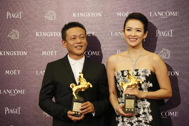 "Best Leading Actor Lee Kang Sheng, left, and actress Zhang Ziyi hold their awards for their films "" Stray Dogs "" and "" The Grandmaster ""at the 50th Golden Horse Awards in Taipei, Taiwan, Saturday, Nov. 23, 2013. The Golden Horse Awards is the Chinese-language film industry's biggest annual events. (AP Photo/Wally Santana)"