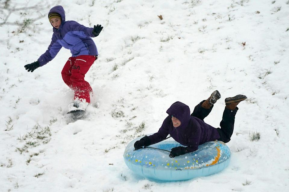 <p>Kids soak up a snow day by snowboard and tube in Lutherville-Timonium, Maryland.</p>
