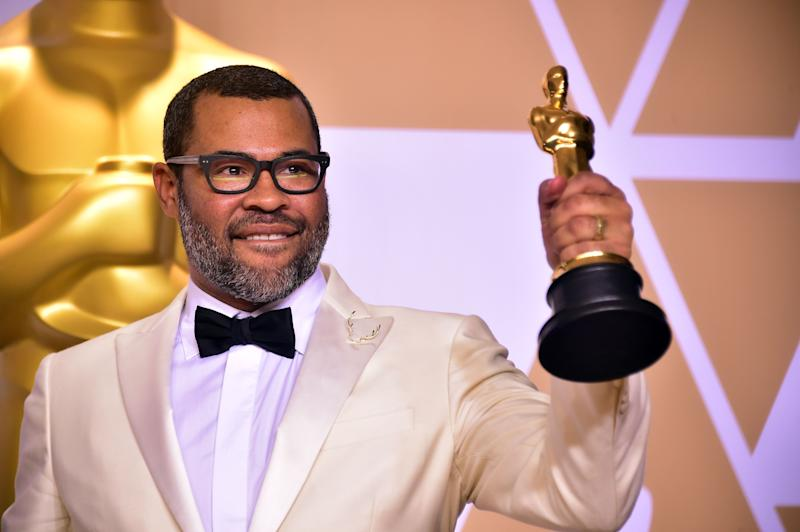 Director Jordan Peele poses in the press room with the Oscar for best original screenplay during the 90th Annual Academy Awards on March 4, 2018, in Hollywood, California. / AFP PHOTO / FREDERIC J. BROWN (Photo credit should read FREDERIC J. BROWN/AFP via Getty Images)