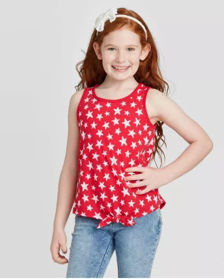 "Find this girls star top for $10 at <a href=""https://yhoo.it/2Zr0Niq"" rel=""nofollow noopener"" target=""_blank"" data-ylk=""slk:Target"" class=""link rapid-noclick-resp"">Target</a>."