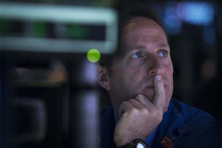 Barclay's specialist trader Glenn Carrell works at his post on the floor of the New York Stock Exchange April 15, 2014. REUTERS/Brendan McDermid