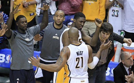 Indiana Pacers forward David West (21) is greeted by teammates after being taken out of the game during the second half of the second game of an NBA first-round playoff basketball series against the Orlando Magic, on Monday, April 30, 2012, in Indianapolis. Indiana defeated Orlando 93-78. (AP Photo/Darron Cummings)