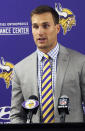Minnesota Vikings new quarterback Kirk Cousins addresses the media after he was introduced during a news conference, after signing a three-year, $84 million contract, at the NFL football team's new headquarters Thursday, March 15, 2018, in Eagan, Minn. (AP Photo/Jim Mone)