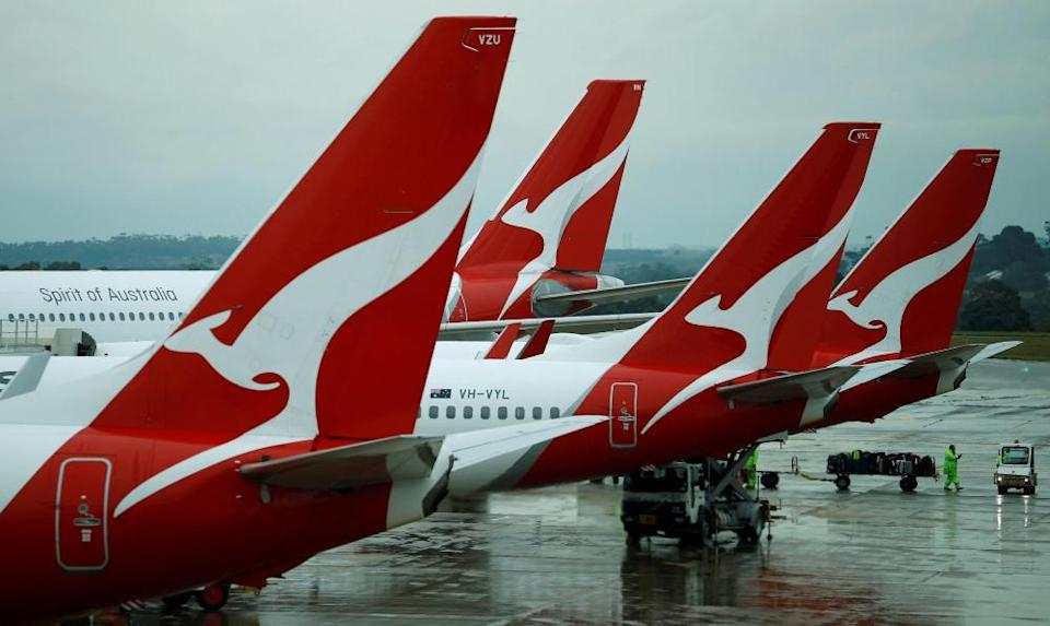Qantas planes on the tarmac at Melbourne airport. International travel has been off the cards for the past 18 months but airlines are pushing for a return to flying.