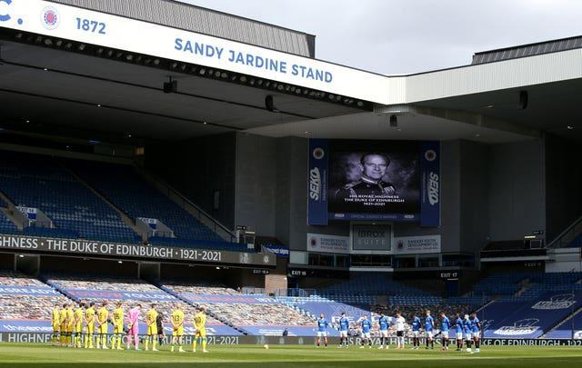 Rangers and Hibernian players observe a two minute silence at Ibrox
